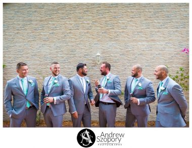 formal portrait photo of groom and groomsmen outside