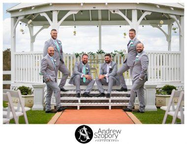 formal portrait photo of groom and groomsmen outside in gazebo