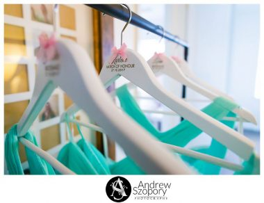 close up of wedding clothes hangers