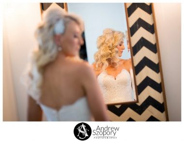 formal window lit portraits of bride reflection of her in a mirror shot from behind