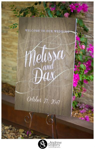 sign showing bride and grooms names and date outside ceremony