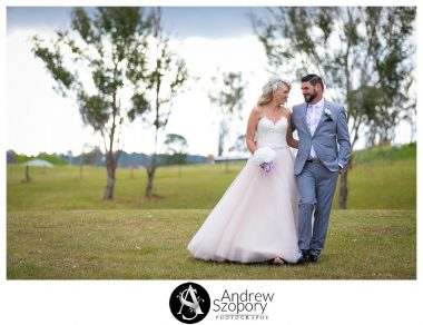 Bride and groom walking in open field at Mulgoa Valley receptions