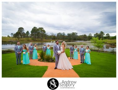 Large bridal party photo group laughing and being playful