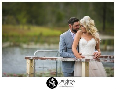 bride and groom stand on a jetty about to kiss