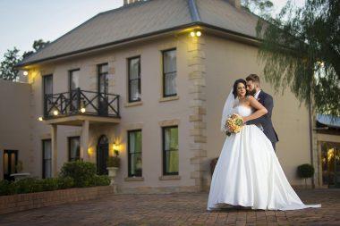 Bride and groom outside Eschol Park House at dusk