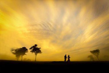 southern-highlands-wedding bride and groom walk at sunset