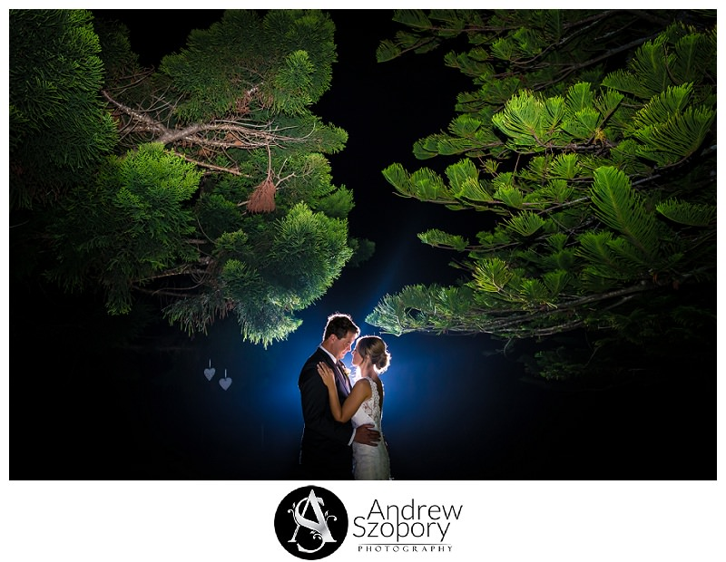 Bride and groom kiss outside at night at Sublime wedding and function centre bulli