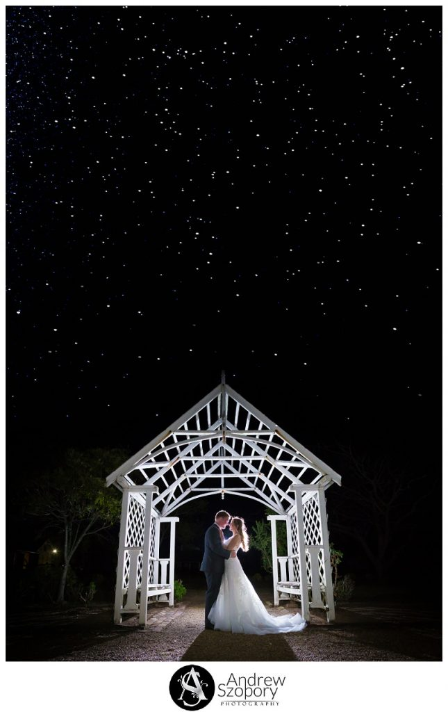 Bride and groom hug at night outside under the stars at Gledswood homsetead in archway